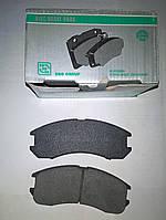 Тормозные колодки передние Mazda 626 (GD)