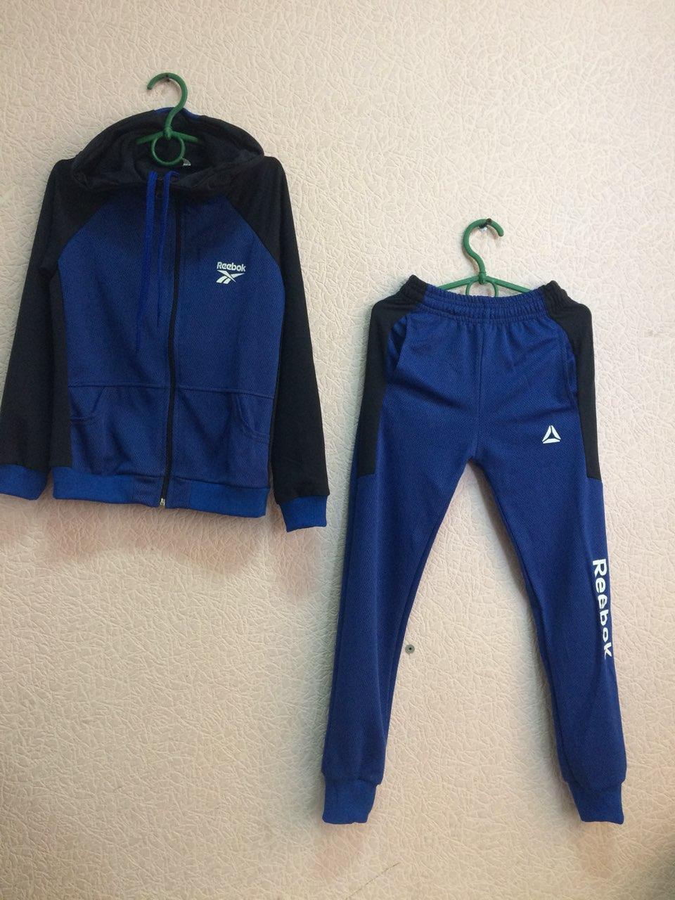 Спортивный костюм юниор Reebok синий оптом - Интернет-магазин женской,  детской, мужской одежды 42f0aa2377f