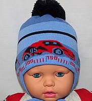 Вязаная шапочка на флисе и завязках. 1-2 года