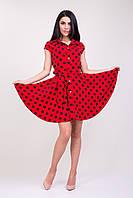 Стильное яркое платье  красного цвета в чёрный горох