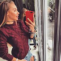 Женский вязаный свитер с узором коса