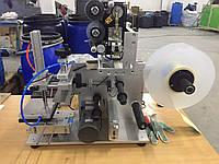 Этикетировщик. Этикетировочная машина. Нанесение этикетки на плоские поверхности