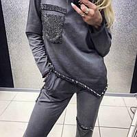 Серый плотный костюм с отделкой камнями и металлом