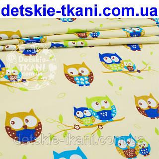 Ткань с голубыми совами на бежевом фоне (№ 105).