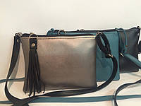 Женская сумка с застежкой -кисточкой