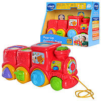 Детская развивающая игрушка-каталка 151103 паровозик красный, 4 песни, музыка (английский), звуки животных, световые эффекты, регулятор громкости,