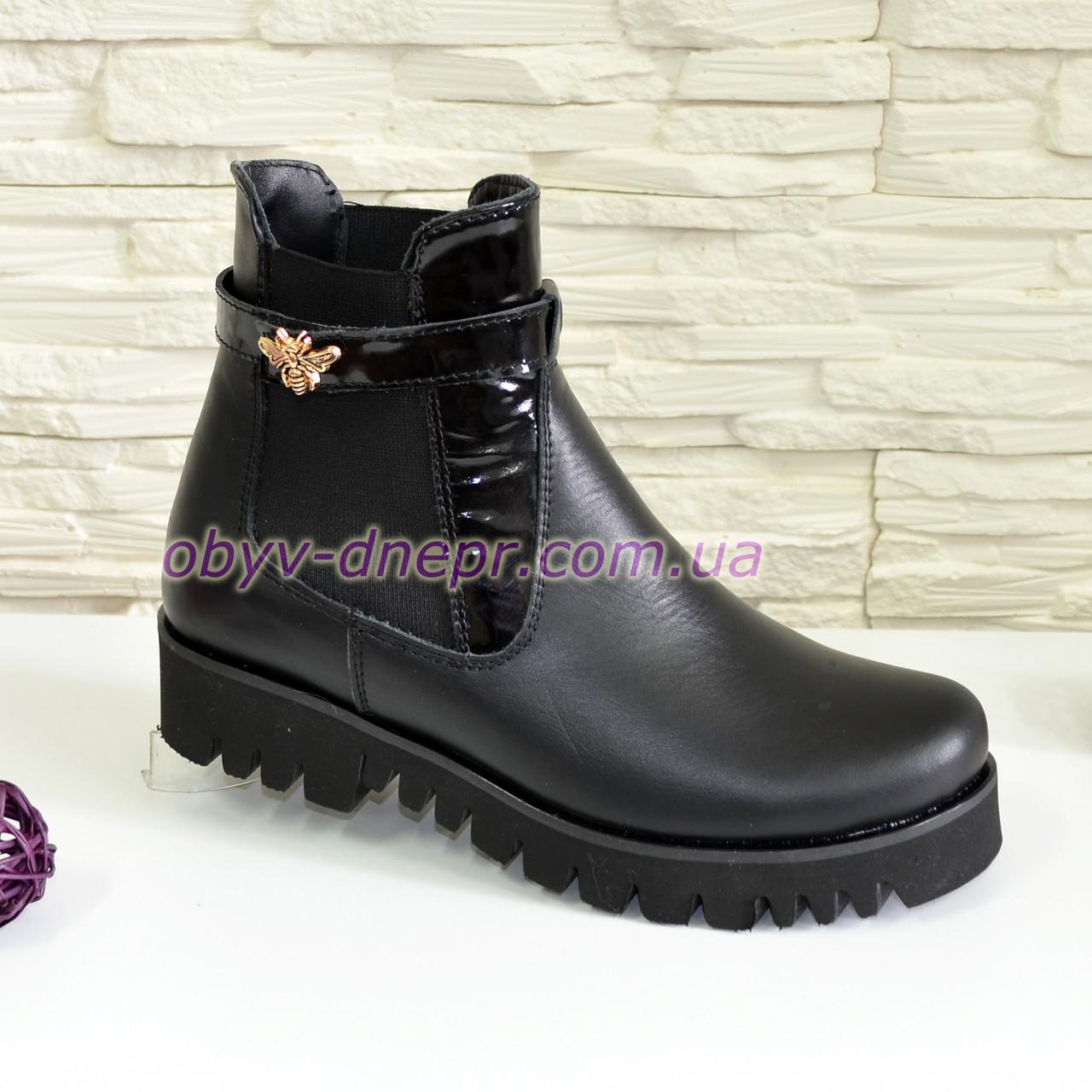 Ботинки кожаные женские   на тракторной подошве, цвет черный.