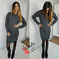 Теплое вязанное платье с косами