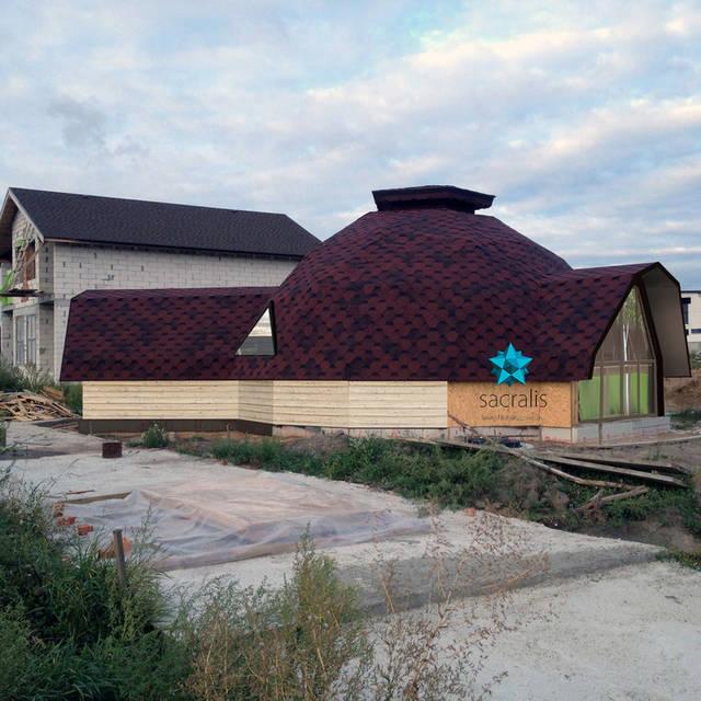 Остекление и обшивка фасада купольного дома