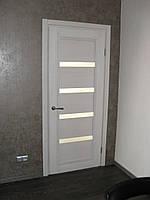 Двери в стиле модерн из натурального дерева.