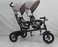 Трёхколёсный велосипед для двойни