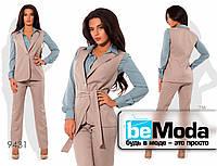 Модный женский костюм  из блузы, жилетки и брюк бежевый