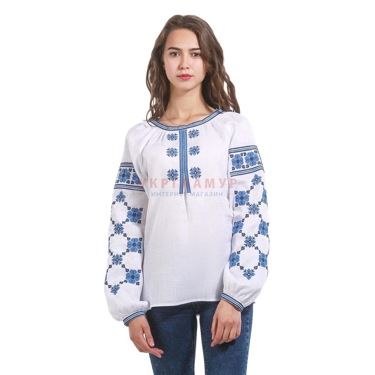 Вышитая дизайнерская женская рубашка белая с синими цветами