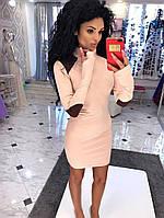 Платье -гольф из плотного трикотажа с латками на плечах и локтях.