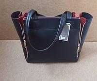 Стильная женская черная сумка с красными вставками