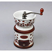 Ручная кофемолка жерновая среднего помола. Размеры -18*11*11 см.