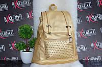 Стильный золотой рюкзак.