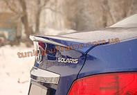 Спойлер-сабля из стеклопластика на Hyundai Accent New (Solaris) 4 2011