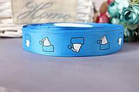 """Лента репсовая с рисунком 2.5 см """"Новогодние колпачки"""" на синем фоне"""