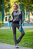 Женский трикотажный темно-серый костюм в спортивном стиле с оригинальной черной отделкой