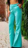 Расклешенные брюки ментолового цвета