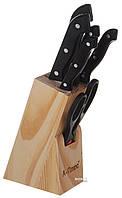 Набор ножей на деревянной подставке