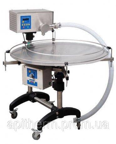 Насос-дозатор для фасовки мёда с автоматическим поворотным столом.Tomasz Łysoń