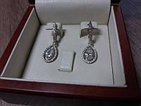Серебряные серьги подвески с белыми камнями