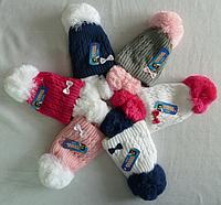 Теплая вязанная шапка на девочку