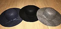 Стильная женская шляпа с полями
