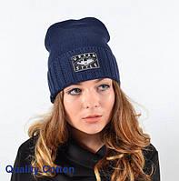 Синяя вязанная шапка