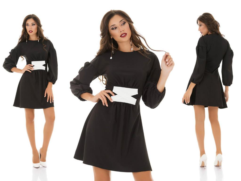 Элегантное платье приталенного силуэта с пышными рукавами