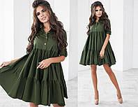 Женское красивое платье с рубашечным воротником и удлиненным низом