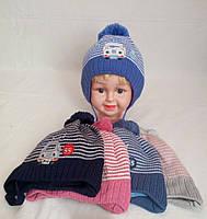 Детская вязаная шапка для девочки на флисе р42-44 оптом