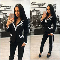 Эффектный женский черно-белый брючный костюм e-402JK