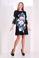 Черное короткое платье трапеция с отделкой из экокожи на рукавах и подоле с цветами Магнолии