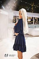 Красивое платье приталенного силуэта, с оборкой на юбке.