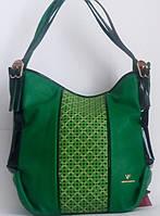 Женская сумка зелёного цвета с перфорацией и стразами