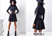 Женское трикотажное платье-клеш с поясом из кожзама