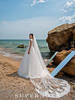 Восхитительное свадебное платье на кокетке с юбкой-шлейф.