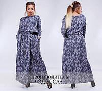 Элегантное платье с принтом, сбоку карманы.