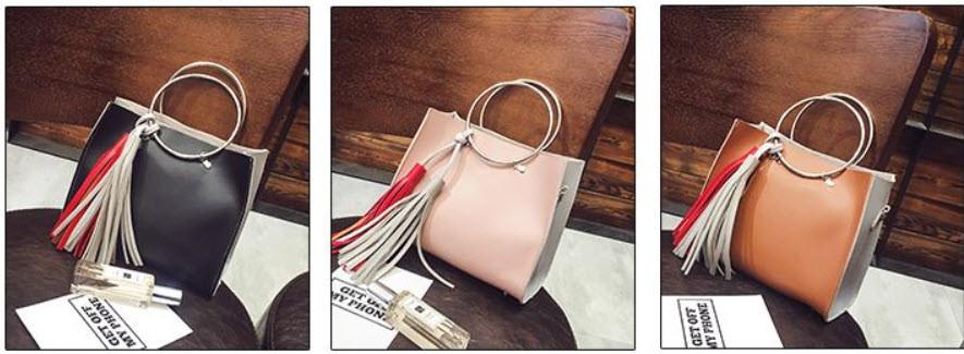 Двухцветная сумочка с ручками-кольцами