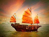 Корабль с оранжевыми парусами