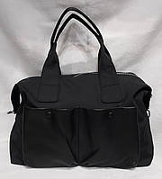 Стильная женская сумка из натуральной кожи и плащевой ткани.