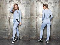 Стильный, женский, спортивный комбинезон со штанами, декорирован отделочной лентой и шевроном.  42-60р