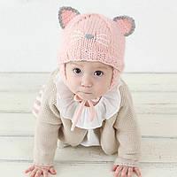 Детская вязаная шапочка с завязками