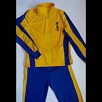 Спортивный костюм из ткани адидас
