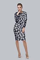 Эффектное женственное платье асимметричного кроя с цельнокроеным рукавом и слегка зауженной книзу юбкой
