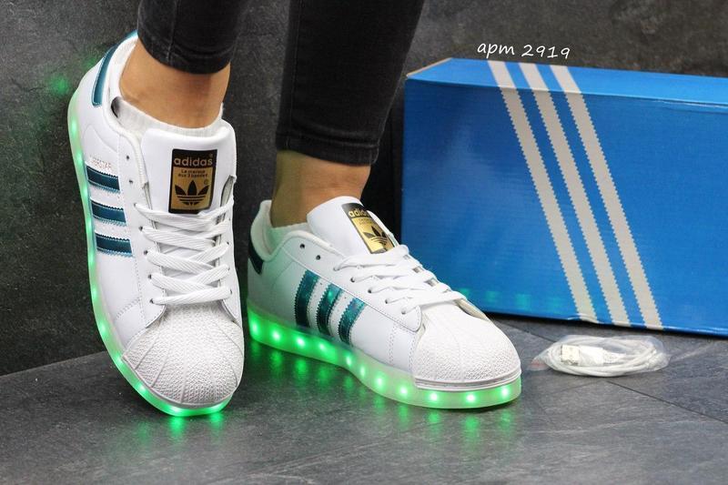 37a61023df12eb Жіночі кеди Adidas Superstar з LED підсвіткою - білі з синіми смужками -  Камала в Хмельницком