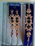 Подовжені вечірні сережки під золото з синіми каменями, висота 12 див., фото 9